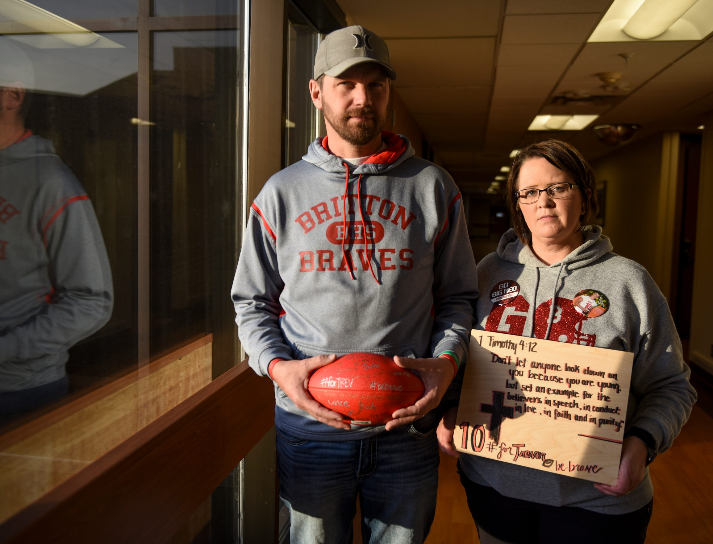 Trevor Zuehlke's parents, Kurt Zuehlke and Nikki Stiegelmeier, hold gifts sent to Trevor Zuehlke as he recovers from a traumatic brain injury on Tuesday, Nov. 12, 2019 at Avera Health. Trevor Zuehlke, a Britton-Hecla High School quarterback, suffered a traumatic brain injury after a football game that left him in a medically induced coma.