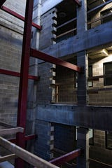 A partially completed elevator shaft stands in one corner of the downtown parking ramp on Tuesday, Nov. 12, in Sioux Falls. An open elevator shaft is a safety hazard, so it will need to be completed before the ramp can open.