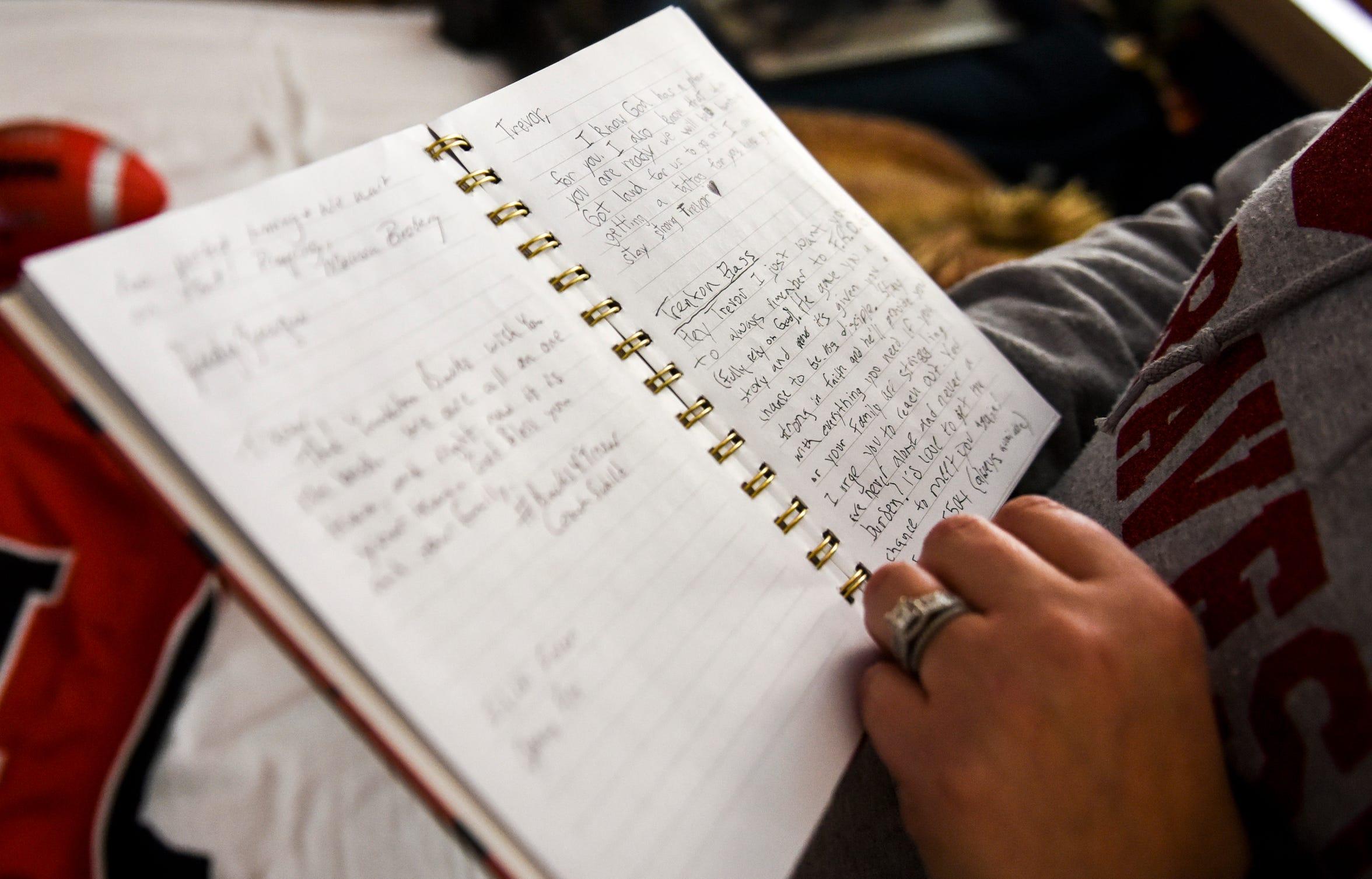 Nikki Stiegelmeier reads notes written to Trevor Zuehlke on Tuesday, Nov. 12, 2019 at Avera Health.