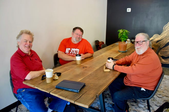 Tom Cardarella (left), Charles Phinizy (center) and Lou Boden (right) gather for a meeting of the Staunton Secular Humanists at Crucible Coffee on Nov. 3, 2019.