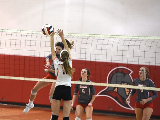Abbey Eavers with the attack in Riverheads' sweep of Altavista in the Region 1B volleyball semifinals
