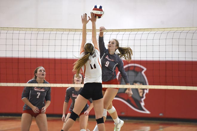 Sydney Phillips with an attack in Riverheads' sweep of Altavista in the Region 1B volleyball semifinals