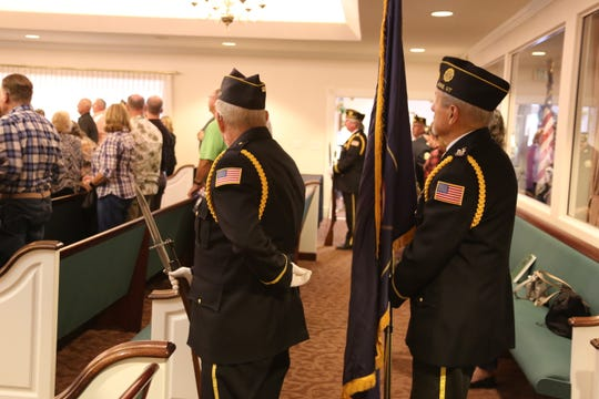 American Legion members conduct the Posting of the Colors ceremony prior to Jennie Taylor's speech at the Spilsbury Mortuary chapel on Nov. 11, 2019.