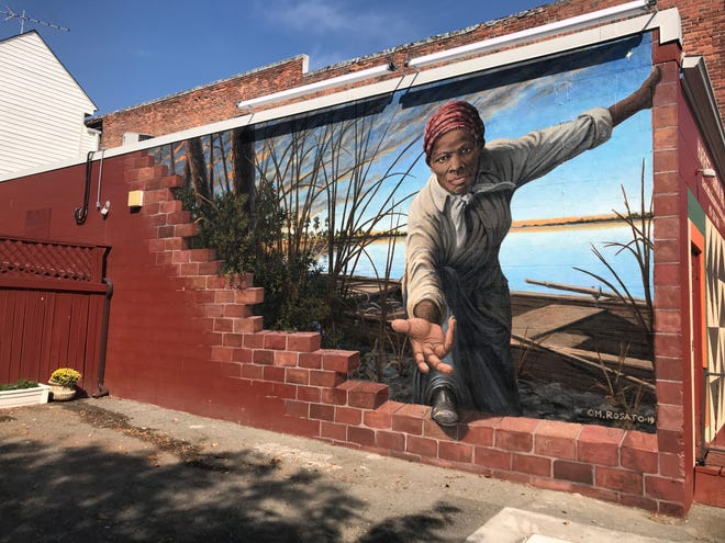 """Michael Rosato will present Dr. A.J. Brickler III, a Tallahassee OB/GYN and 2nd great grandnephew of Harriet Tubman, a signed print of his famed mural """"Take My Hand."""""""