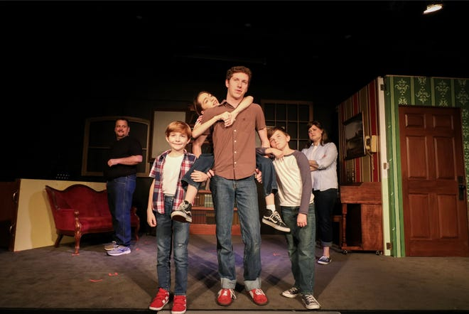 "The Bechdel family has different opinions about their babysitter Steve (Spencer Lail) in the New Stage Theaterworks production of ""Fun Home."""