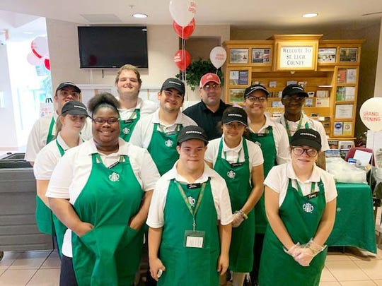 Starbucks Manager Glenn Camelio, back row, and the Student Perks team at the grand opening of the Student Perks kiosk in the Port St. Lucie Administration Building on Oct. 28, 2019.