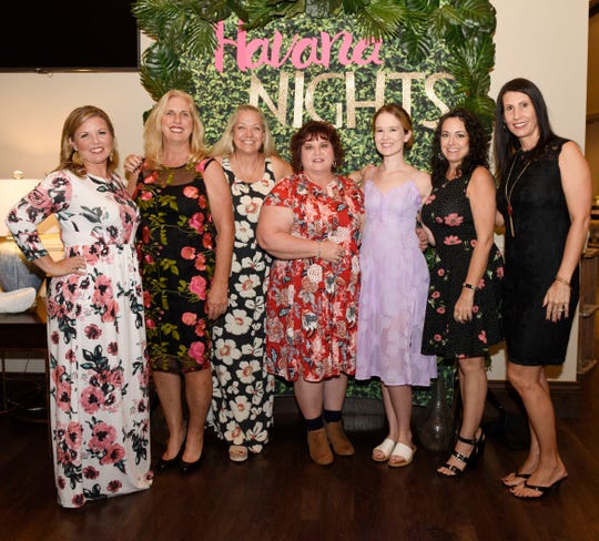 "Jennifer Patterson, left, Kim Collins, LaDeene Dodson, Dana Neville, Christine Jones, Connie Agler and Stephanie Ellingham attend ""The Secrets of Havana"" Murder Mystery Dinner on Nov. 2, 2019, at Aycock in Tradition, a benefit for The Royal Palms."