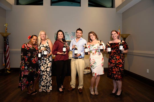 """The Secrets of Havana"" Murder Mystery cast members, from left, Fabiola Simon, LaDeene Dodson, Luv Lima, Phil and Kaitlin Goedeke and Jennifer Wiggins at Royal Palms' fundraiser at Aycock in Tradition on Nov. 2, 2019."