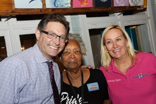 WPTV's Jon Shainman, left, Marjory Harrell and Martha Taylor at Family Meals' Celebrity Bartenders Event at Cobb's Landing in Fort Pierce on Nov. 6, 2019.