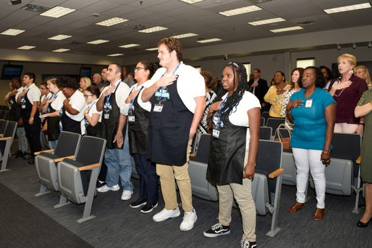 Students in St. Lucie County's Exceptional Student Education program say the Pledge of Allegiance at a recent County Commission meeting where October was proclaimed Disability Employment Awareness Monthand National Disability Employment Awareness Month.