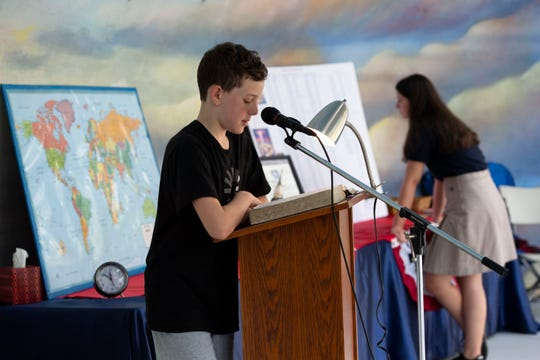 Rob Thompson, 10, of Port St. Lucie, reads out of Joshua, a book in the Bible's Old Testament, during a nonstop reading of the Christian text during the 19th annual Martin County Bible Reading Marathon on Tuesday, Nov. 12, 2019, inside the bandshell at Memorial Park in Stuart. Thompson's neighbors, Joanne and Eddie Rodrigues, host the annual event.