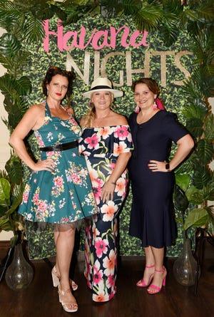 "Kara Johnson, left, Laura Mulholland and Angela Ellis attend ""The Secrets of Havana"" Murder Mystery Dinner onNov.2, 2019,at Aycock in Tradition."
