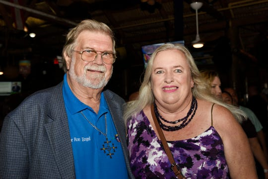 Pastor Ron Engel, left, and Claire Graff attend Family Meals' Celebrity Bartenders Event at Cobb's Landing in Fort Pierce  on Nov. 6, 2019.