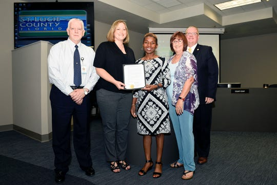Bill Tomlinson, left, executive director of Exceptional Student Education and Student Services; Brooke Wigginton, principal of Port St. Lucie High School; Andrea Popwell, principal of St. Lucie West Centennial High School; St. Lucie County Commissioner Linda Bartz, and St. Lucie County Interim Human Resource Director Doug Baber recognize October as Disability Employment Awareness Month and National Disability Employment Awareness Month.