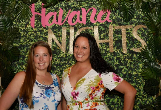 "Julie Spencer, left, and Amanda McCarty attend ""The Secrets of Havana"" Murder Mystery Dinner on Nov. 2, 2019, at Aycock in Tradition, a benefit for The Royal Palms."