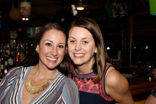 Volunteers Jessica Palmer, left, and Elizabeth Privateer at Family Meals' Celebrity Bartenders Event at Cobb's Landing in Fort Pierce on Nov. 6, 2019.