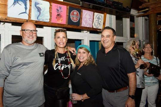Family Meals' Celebrity Bartenders Brett Mercurio, left, Gabby Rothman, Maryann Matteo and Brad Gould at Cobb's Landing in Fort Pierce on Nov. 6, 2019.