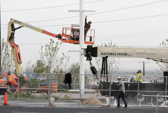 Workers erect the permanent Walmart memorial Nov. 12, 2019, in the parking lot of the store where 22 people were killed and 25 others were wounded on Aug. 3, 2019. The store reopened at 9 a.m. Nov. 14, 2019.
