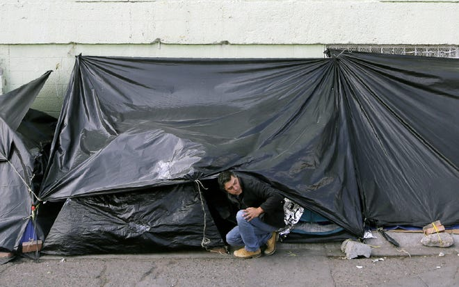 Mexican asylum-seekers camped out in the streets of Juárez at the base of the Paso Del Norte international bridge are dealing with frigid conditions as they sleep in tarp-covered tents. Most are refusing an offer by the Mexican government to move them into shelters.