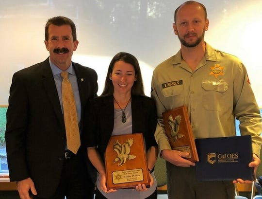 From left, Ventura County Sheriff Bill Ayub stands next to Heather D'Anna and Brandon Nichols, who were honored for their efforts to rescue two fallen hikers.