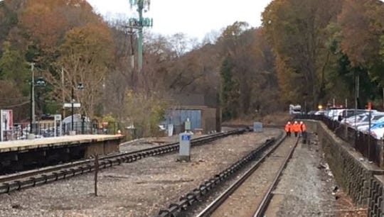 Workers are on the southbound tracks at the Hartsdale train station after a vehicle struck a utility pole, sending wires onto the tracks, Nov. 12, 2019. The accident delayed Harlem Line trains.