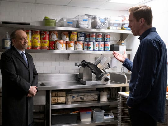 "Paul Giamatti as Chuck Rhoades and Damian Lewis as Bobby ""Axe"" Axelrod in ""Billions."""