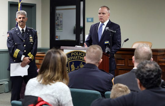 Irvington police chief Michael Cerone looks on as Michael Green, executive deputy commissioner of NYS division of criminal justice service, presents police officer Arcangelo Liberatore a Lifesaving Award Nov. 12, 2019 at Irvington Justice Court. Officer Liberatore rescued a 5-year-old girl from a rabid coyote while off-duty in a park with his family last year.