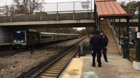 Northbound tracks are in service at the Hartsdale station after a vehicle struck a utility pole nearby, Nov. 12, 2019. Police are blocking that stairway to the street above because they said there are concerns about live wires nearby.