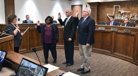Incumbent Wichita Falls City Councilors DeAndra Chenault, District 2, and Bobby Whiteley, At-Large, and Michael Smith, right, returns as District 1 councilor during a swearing-in ceremony Tuesday morning.