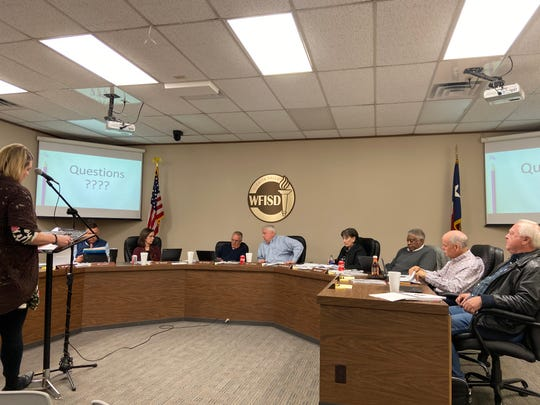 Jackie Wheat, left, gives a report on performance goals and strategies at the Wichita Falls ISD Board of Trustees meeting Tuesday. The board agreed to consider using a revenue surplus for capital improvements or environmental enhancements at WFISD campuses.