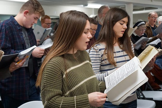 Josiah Gross, left, Emma Gross, center, and Megan Judson, right are among the youngest of the 90-member choir who will be performing Handel's Messiah on Dec. 15.