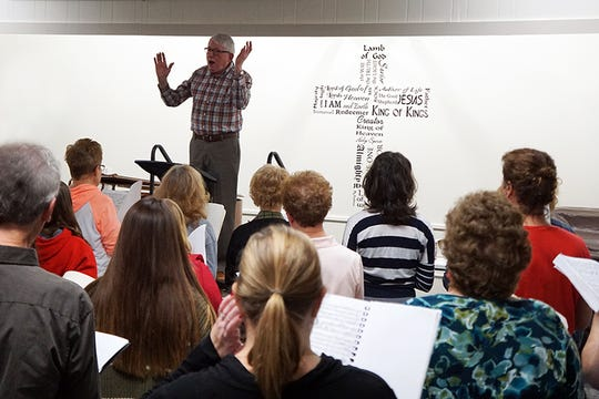 The Zanesville Civic Chorus, under the direction of Jim McLaughlin, practices for the 90th performance of Handel's Messiah. The group will perform at Carnegie Hall in New York on DecM1 and in Zanesville on Dec. 15.