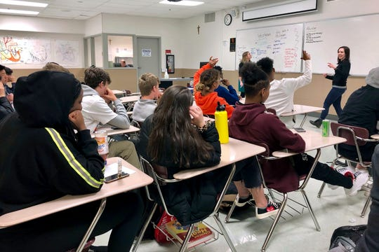 In this April 15, 2019, file photo, instructors from Raphael House lead a classroom discussion about consent and healthy relationships with a class of sophomores at Central Catholic High School in Portland, Ore.