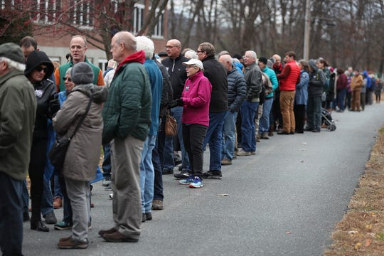 People wait in line at the doors to hear Democratic presidential candidate Pete Buttigieg speak at a town hall event at the Walpole Middle School.