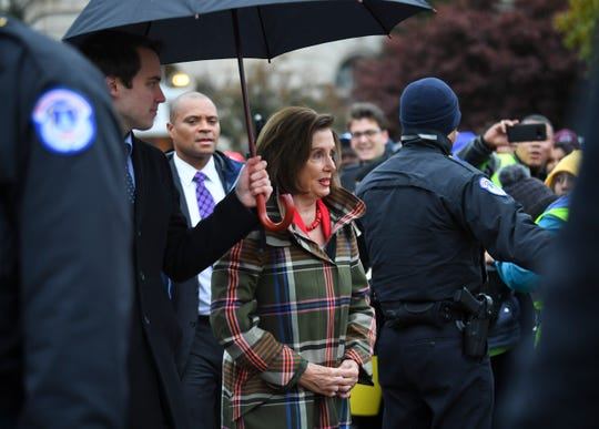 House Speaker Nancy Pelosi, D-Calif., making her way through the crowd in front of the Supreme Court building Tuesday as the court hears arguments on whether the 2017 Trump administration decision to end the Deferred Action for Childhood Arrivals program (DACA) is lawful.