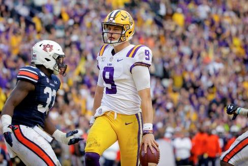 LSU quarterback Joe Burrow  celebrates as he runs in for a touchdown during the fourth quarter against Auburn.