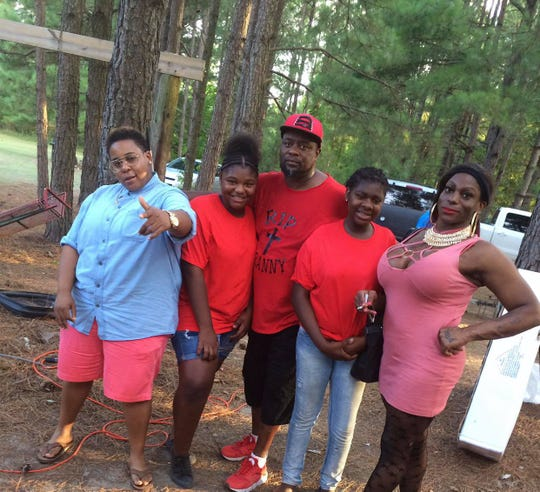 Cathalina Christina James (right) is pictured with her sisters (left to right) De'Andra, Jada and Shadonna James and father (center) Donald James. Cathalina Christina James was found dead in June 2018 and no suspect has been arrested in the homicide investigation.