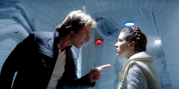 Harrison Ford as Han Solo and Carrie Fisher as Princess Leia