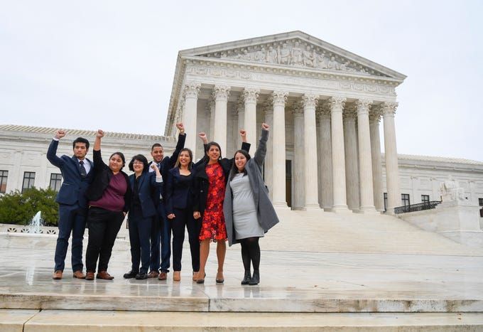 Carolina Fung Feng, third from left, Martin Batalla Vidal, fourth from left, and Eliana Fernandez, third from right join other DACA recipients heading into hear arguments before the U.S. Supreme Court on whether the 2017 Trump administration decision to end the Deferred Action for Childhood Arrivals program (DACA) is lawful on Nov. 12, 2019.