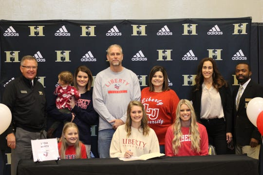 Lydia Burts (volleyball) signs her letter of intent with Liberty University.