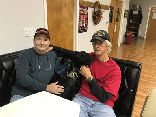 Billy Konrad, left, is pictured with Steve Hartington and Steve's service dog, Barrett. Hartington donated his kidney to Konrad this year.