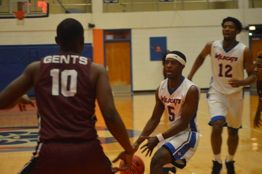 Louisiana College's Kae'ron Baker (5) goes to the lane against Centenary Tuesday.