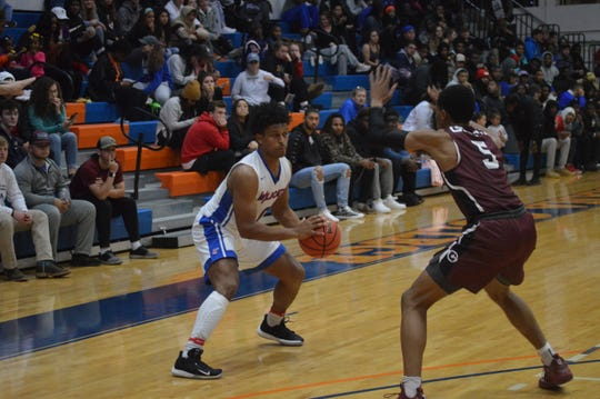 Louisiana College's Denzel Austin (0) looks to drive against Centenary's Kile Mingo Tuesday.