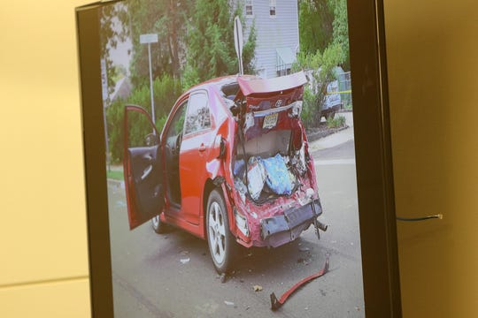 An image of the car owned by Robert Matich of Keansburg, who was hit by the defendant in the accident, is shown on a screen as he testifies during the trial of Alexandra Mansonet, who is charged with vehicular homicide for allegedly texting and driving, before Superior Court Judge David F. Bauman at Monmouth County Courthouse in Freehold, NJ Wednesday, November 13.