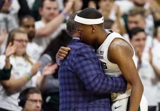 Michigan State Spartans guard Cassius Winston (5) hugs Michigan State Spartans head coach Tom Izzo against Binghamton.