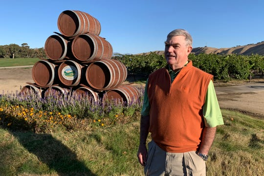 In this Oct. 4, 2019 photo, Eric Wente, chairman of Wente Vineyards, stands near vineyards at his family-run winery, which was founded by his great grandfather in 1883 in Livermore, Calif. Caught in the crossfire of President Donald Trump's trade war with China, U.S. vineyards are struggling to sell Syrah in Shanghai and Chardonnay in Shenzhen. They risk losing their foothold in one of the world's fastest-growing wine markets. Among the casualties is California's Wente Vineyards, that was among the first U.S. winemakers to export to China 25 years ago. (AP Photo/Terry Chea)