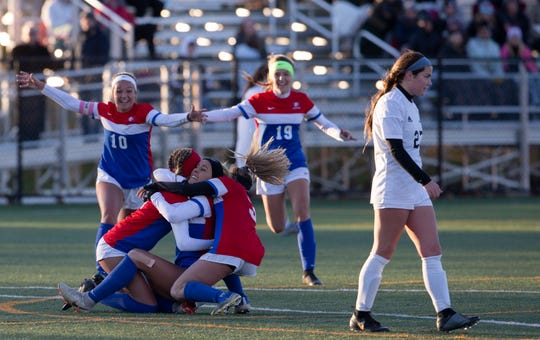 Wall Mackenzie Tranberg is mobbed by her teammates after scoring the winning goal in overtime. Wall Girls Soccer defeats Haddonfield 2-1 in overtime Group II State Semifinal in Wall, NJ on November 13, 2019.
