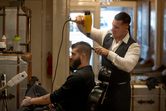 David Fantigrossi, owner of Old World Shaving Parlor in Red Bank puts the finishing touches on Alex Riley of Red Bank on November 13, 2019.