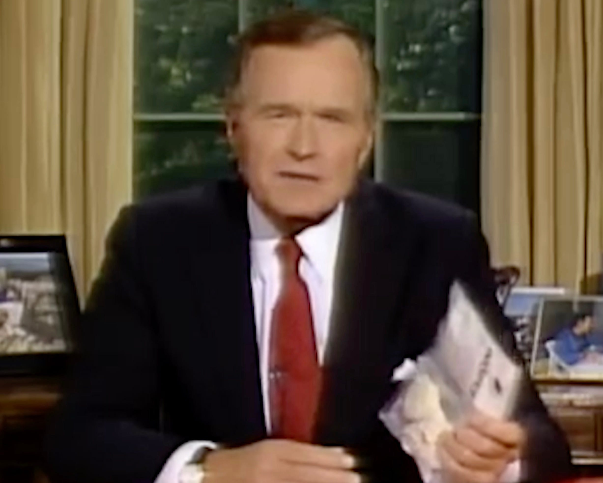 President George H. W. Bush during a 1989 televised address holds up a bag of crack cocaine purchased from a dealer outside the White House.