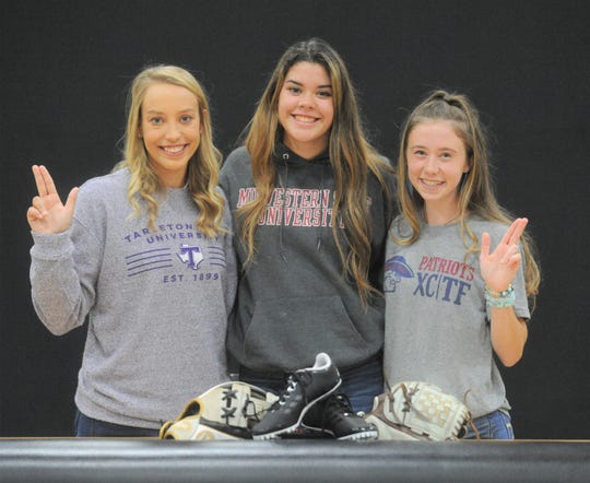 From left, Peyton Lee, Kaitlyn Turner and Megan Smith pose at their signing ceremony Wednesday, Nov. 13, 2019, at Clyde High School.